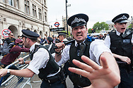 London, UK. 27th May, 2015. Several hundred  anti-government demonstrators take to the streets in central London on the day of the State Opening of parliament, just over a fortnight after an anti-Tory protest in Whitehall led to clashes with police and several arrests.  Pictured: Skirmishes between protesters and police breakout in Whitehall as the police try to contain the demonstrators. // Lee Thomas, Flat 47a Park East Building, Bow Quarter, London, E3 2UT. Tel. 07784142973. Email: leepthomas@gmail.com. www.leept.co.uk (0000635435)