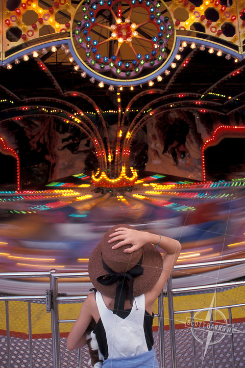 Girl watching amusement park ride