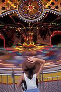 Girl watching amusement park ride