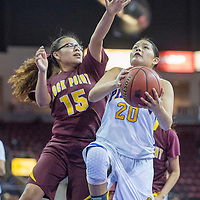 Valley Sanders Pirate Cherelle Speen (20) gets past Rock Point Cougar Keandra Sam (15) Saturday at the Prescott Valley Event Center.