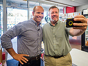 23 MAY 2019 - DES MOINES, IOWA: Congressman JOHN DELANEY (D-MD), left, poses for a selfie with an Iowa public school teacher during a tour of the Iowa Food Cooperative in Des Moines. He toured the co-op to help understand how Iowa farmers are finding new markets. Delaney is running to be the Democratic nominee for the US Presidency in the 2020 election and has visited all 99 of Iowa's counties. Iowa traditionally hosts the the first election event of the presidential election cycle. The Iowa Caucuses will be on Feb. 3, 2020.                           PHOTO BY JACK KURTZ