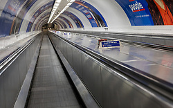 © Licensed to London News Pictures. 16/03/2020. London, UK. An empty moving walkway at Bank Tube Station at 9:20am this morning as increasing numbers of people are working from home. New cases and fatalities resulting from the COVID-19 strain of the Coronavirus continue to be reported daily in the UK with major sporting fixtures cancelled and people advised to stay at home if they have a cough and high temperature. Photo credit: Vickie Flores/LNP
