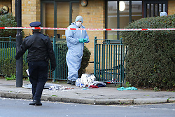 © Licensed to London News Pictures. 12/01/2020. London, UK. Police and forensic officers at the crime scene in Upper North Street in Tower Hamlets, where a teenage boy with stab injuries to his chest was discovered and taken to an east London hospital at 3. 30am this morning where he remains in a life threatening condition. A 15-year-old boy has been arrested and taken into custody. Photo credit: Vickie Flores/LNP