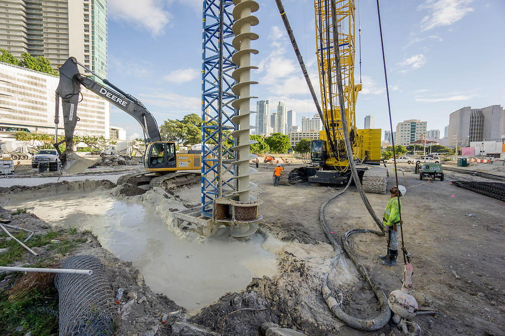 MIAMI,  FLORIDA--- NOVEMBER 3, 2015: <br /> Machinery and construction workers labor on the grounds of what will become Paramount Miami Worldcenter in downtown Miami. The 60 story condo tower with 470 residences will sit atop the the Miami Worldcenter Mall. (Photo by Angel Valentin)