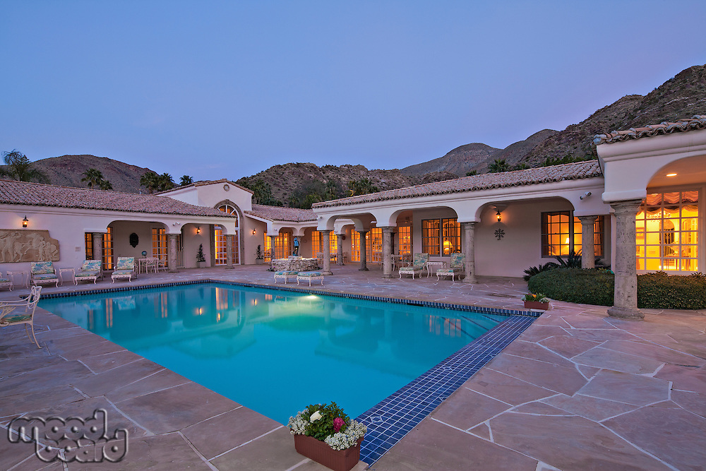 Swimming pool in luxurious villa in evening