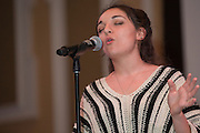 Lena Theodore, an Ohio University student, sings during the International Women's Day Festival on March 13, 2016. Photo by Emily Matthews
