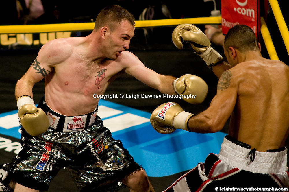 Colin Lynes defeats Young Mutley (black,red stripe shorts) at London Olympia -  Prizefighter Light Welterweights 4th December 2009 Credit: © Leigh Dawney Photography