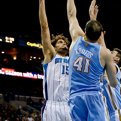Mar 25, 2013; New Orleans, LA, USA; New Orleans Hornets center Robin Lopez (15) shoots over Denver Nuggets center Kosta Koufos (41) and small forward Danilo Gallinari (8) during the second quarter of a game at the New Orleans Arena. Mandatory Credit: Derick E. Hingle-USA TODAY Sports