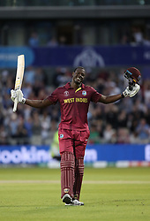 West Indies Carlos Brathwaite celebrates his 100 during the ICC Cricket World Cup group stage match at Old Trafford, Manchester.