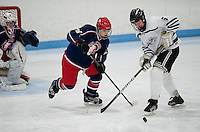 Laconia-Winnisquam's Josh Shelvin and Moultonboro-Interlakes Aidan Conn go after the puck at the net during NHIAA Division III hockey at the Laconia Ice Arena Saturday evening.  (Karen Bobotas/for the Laconia Daily Sun)