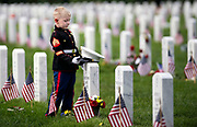 Christian Jacobs, 5, visits the grave of his father Marine Sgt. Christopher Jacobs at Arlington National Cemetery on Memorial Day in Arlington, Virginia.