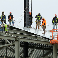 Work crews make measurements for roof panels during the renovation of Dudy Noble Field at Mississippis State University on Wednesday morning in Starkville.