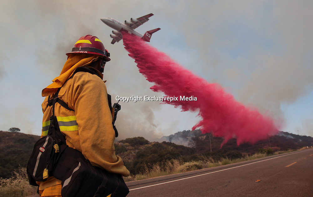 June 20, 2016 - Duarte, California, U.S. -Upland Fire Capt. JOE BURNA watches as a tanker drops fire retardant to stop a wildfire from jumping over Highway 94 near Potrero on Monday. <br /> &copy;Exclusivepix Media