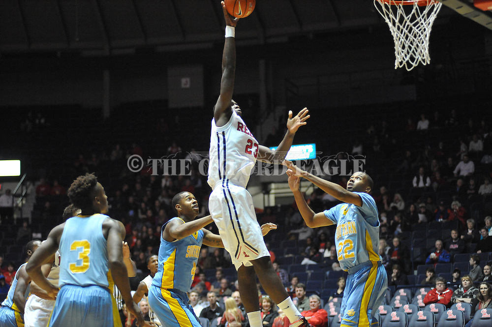 """Ole Miss' center Dwight Coleby (23) scores over Southern University Jaguars center Frank Snow (22) at the C.M. """"Tad"""" Smith Coliseum in Oxford, Miss. on Thursday, November 20, 2014. (AP Photo/Oxford Eagle, Bruce Newman)"""