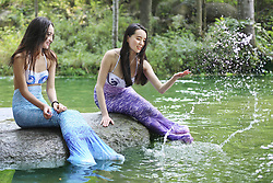 July 2, 2017 - Pingdingshan, Pingdingshan, China - Pingdingshan, CHINA-July 2 2017: (EDITORIAL USE ONLY. CHINA OUT)..Eight online celebrities wearing mermaid costumes stream live videos at a scenic area in Pingdingshan, central China's Henan Province, July 2nd, 2017. (Credit Image: © SIPA Asia via ZUMA Wire)