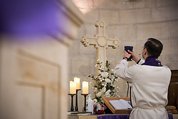 1 March 2020, Bethlehem: Rev. Munther Isaac prepares Holy Communion during Sunday service in the Evangelical Lutheran Christmas Church in Bethlehem.