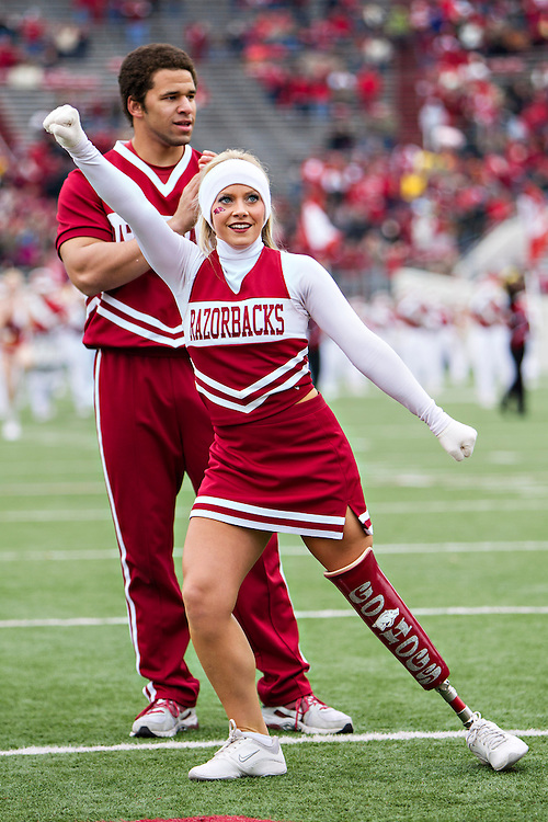 LITTLE ROCK, ARKANSAS - NOVEMBER 23:  Arkansas Razorbacks cheerleader Patience Beard with her new Go Hogs prosthetic leg performs before a game against the Mississippi State Bulldogs at War Memorial Stadium on November 23, 2013 in Little Rock, Arkansas.  The Bulldogs defeated the Razorbacks 24-17.  (Photo by Wesley Hitt/Getty Images) *** Local Caption *** Patience Beard