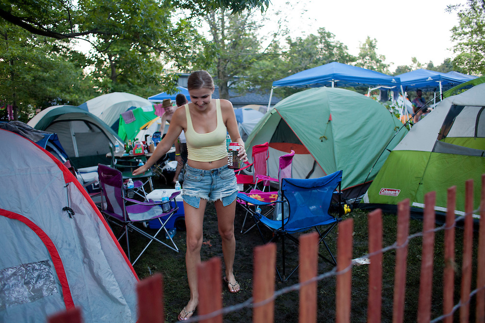 Haley Wood navigates the warrant of tents at  Camp Euforia north of Lone Tree on Friday, July 17, 2015.
