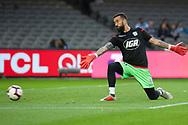 Adelaide United goalkeeper Paul Izzo (20) warms up at the Hyundai A-League Round 7 soccer match between Melbourne Victory v Adelaide United at Marvel Stadium in Melbourne, Australia.