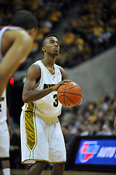 Jan 23, 2010; Columbia, MO, USA; Missouri Tigers guard Miguel Paul (3) shoots a free throw in the second half of the game against the Nebraska Cornhuskers at Mizzou Arena in Columbia, MO. Missouri won 70-53. Mandatory Credit: Denny Medley-US PRESSWIRE