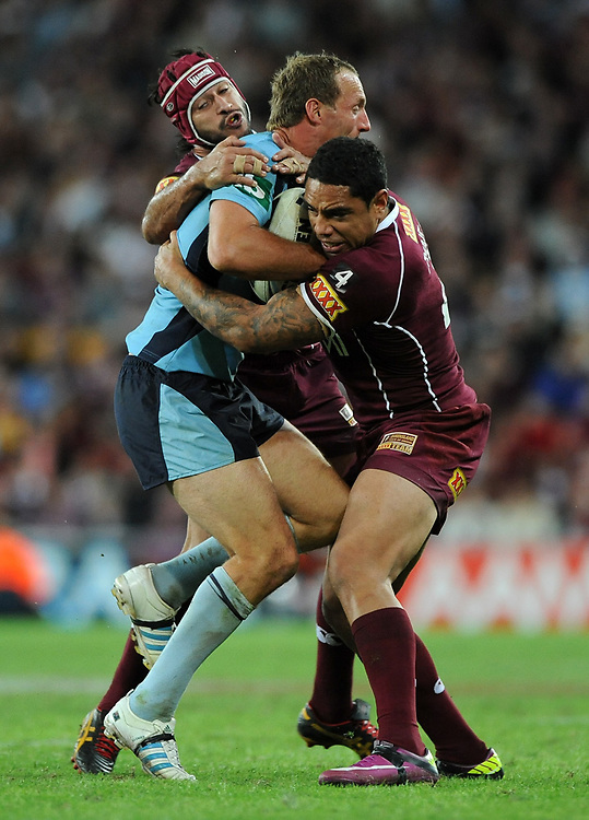 May 25th 2011: Maroons, Willie Tonga and Johnathan Thurston tackle Mark Gasnier of the Blues during game 1 of the 2011 State of Origin series at Suncorp Stadium in Brisbane, Australia on May 25, 2011. Photo by Matt Roberts/mattrIMAGES.com.au / QRL
