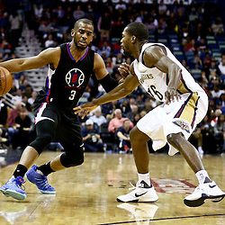 Mar 20, 2016; New Orleans, LA, USA; Los Angeles Clippers guard Chris Paul (3) drives past New Orleans Pelicans guard Toney Douglas (16) during the first quarter of a game at the Smoothie King Center. Mandatory Credit: Derick E. Hingle-USA TODAY Sports