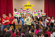 Staff and students participate in a flash mob during a pep rally to energize for STAAR testing at Garcia Elementary School, March 27, 2014.