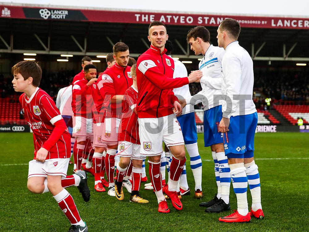 Joe Bryan shakes hands with Josh Scowen of Queens Park Rangers as Bristol City greet Queens Park Rangers before kick off - Rogan/JMP - 27/01/2018 - Ashton Gate Stadium - Bristol, England - Bristol City v Queens Park Rangers - Sky Bet Championship.