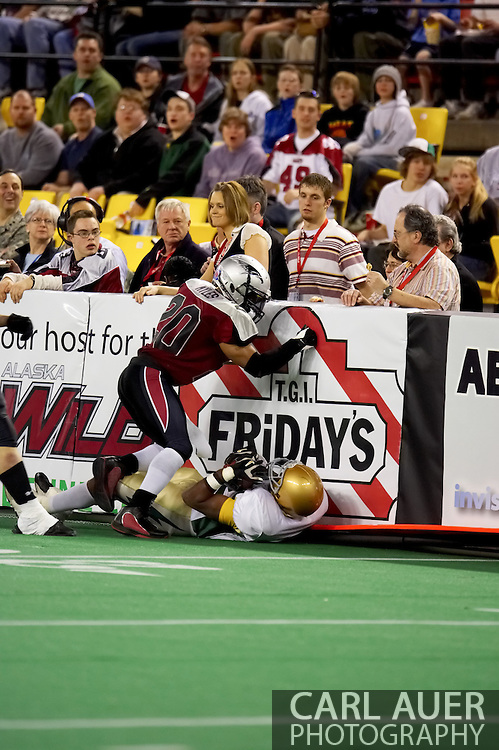 4/12/2007 - Delvin Myles (20) makes a stop against the Frisco Thunder in the 33-46 loss to the Thunder in the first professional football game in Alaska.