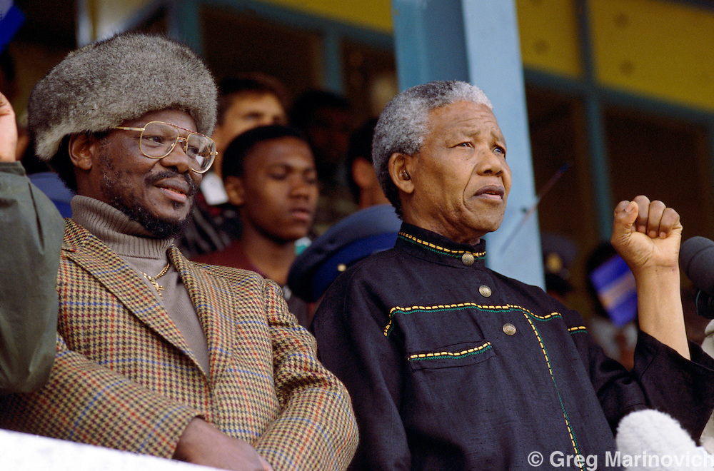 Nelson Mandela and IFP leader Chief Mangosuthu Buthelezi, address a joint rally of their supporters at Orlando Stadium, Soweto, 1994
