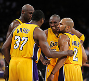 After Kobe Bryant was fouled in the final moments, he grimmaced while talking to Lamar Odom, Ron Artest and Derek Fisher as the considered a plan for the final seconds. The Lakers defeated the Boston Celtics in game 7 of the NBA Finals  83-79 in Los Angeles, CA 06/16/2010 (John McCoy/Staff Photographer)