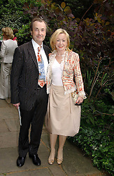 DAVID McALPINE and his wife actress ANGHARAD REES at the annual Macmillan Cancer Support House of Lords vs the House of Commons Tug of War held in Victoria Tower Gardens on 20th June 2006.<br /><br />NON EXCLUSIVE - WORLD RIGHTS