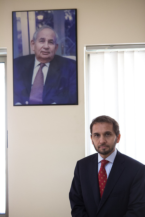 Portrait of His Royal Highness Prince Raad bin Zeid al-Hussein, Chief Chamberlain of His Majesty King Abdullah II bin Hussein of Jordan. A portrait of his father in the background.