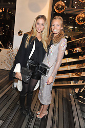 Left to right,FLORENCE BRUDENELL-BRUCE and MARTHA WARD at a party to celebrate the launch of a limited edition shoe The Chambord in celebration of Nicholas Kirkwood's partnership with Chambord black raspberry liqueur, held at the Nicholas Kirkwood Boutique, 5 Mount Street, London on 12th December 2012.
