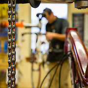 Lloyd Wiser works on a bike in the maintenance shop of Fitzgerald's Bike Shop.