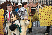 Mexican Matadors and Picadors prepare for the bullfights at the Plaza de Toros in San Miguel de Allende, Mexico. Picadors ride horses surrounded by a peto, a mattress-like protection that greatly minimizes damage to the animal during the bullfight.