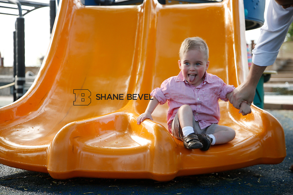 5/28/15 6:04:58 PM -- Miracle Miles and his family pose for portraits and play at the QuikTrip park for the 2015 Saint Francis Health System advertising campaign. <br /> <br /> Photo by Shane Bevel
