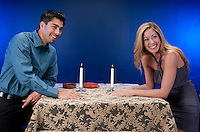 Couple having fun in a reataurant or night club atmosphere. Young adult male with mature woman.
