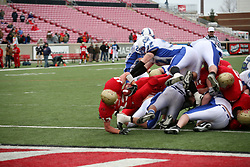 Bullitt East hosted Bell County in the Class 4A KHSAA Commonwealth Gridiron Bowl on Saturday, Dec. 13, 2008, at Papa John's Cardinal Stadium in Louisville, Ky. Bullitt East's Zach MCarthy, left, jumps into the end-zone one yard for a touchdown giving Bullitt East the lead 7-0.(photo by Jonathan Palmer)