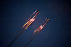 © Licensed to London News Pictures. 10/08/2012. Bristol, UK. The nightime Illuminair aerobatic display at the Jones Lang LaSalle Bristol International Balloon Fiesta, which runs from 09-12 August at Ashton Court in Bristol.  This year's fiesta is sponsored by Jones Lang LaSalle. 10 August 2012..Photo credit : Simon Chapman/LNP