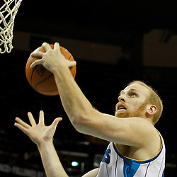February 6, 2012; New Orleans, LA, USA; New Orleans Hornets center Chris Kaman (35) grabs a rebound against the Sacramento Kings during the second half of a game at the New Orleans Arena. The Kings defeated the Hornets 100-92.  Mandatory Credit: Derick E. Hingle-US PRESSWIRE