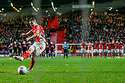 Charlton Athletic midfielder Josh Cullen (24) takes his penalty during the EFL Sky Bet League 1 second leg Play-Off match between Charlton Athletic and Doncaster Rovers at The Valley, London, England on 17 May 2019.
