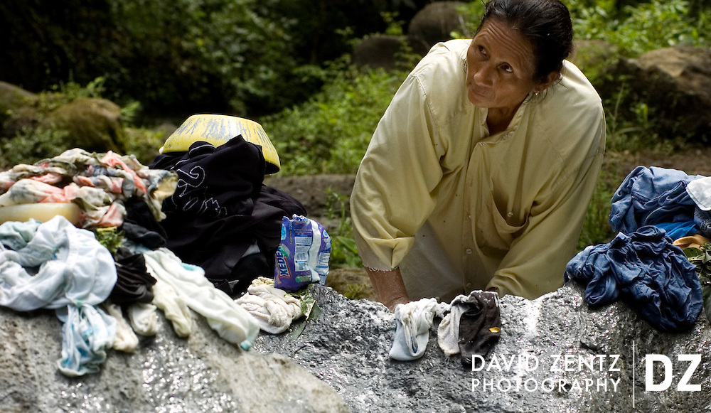 A woman washes laundry in a stream in a remote area of the rural Carazo region of Nicaragua on October 1, 2004. Many homes in the region do not have running water.
