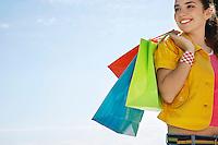 Teenage girl carrying shopping bags outdoors
