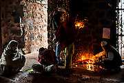 """8th January 2015, New Delhi, India. Believers pray, make offerings and ask for wishes to be granted by Djinns in the ruins of Feroz Shah Kotla in New Delhi, India on the 8th January 2015<br /> <br /> PHOTOGRAPH BY AND COPYRIGHT OF SIMON DE TREY-WHITE a photographer in delhi<br /> + 91 98103 99809. Email: simon@simondetreywhite.com<br /> <br /> People have been coming to Firoz Shah Kotla to leave written notes and offerings for Djinns in the hopes of getting wishes granted since the late 1970's. Jinn, jann or djinn are supernatural creatures in Islamic mythology as well as pre-Islamic Arabian mythology. They are mentioned frequently in the Quran  and other Islamic texts and inhabit an unseen world called Djinnestan. In Islamic theology jinn are said to be creatures with free will, made from smokeless fire by Allah as humans were made of clay, among other things. According to the Quran, jinn have free will, and Iblīs abused this freedom in front of Allah by refusing to bow to Adam when Allah ordered angels and jinn to do so. For disobeying Allah, Iblīs was expelled from Paradise and called """"Shayṭān"""" (Satan).They are usually invisible to humans, but humans do appear clearly to jinn, as they can possess them. Like humans, jinn will also be judged on the Day of Judgment and will be sent to Paradise or Hell according to their deeds. Feroz Shah Tughlaq (r. 1351–88), the Sultan of Delhi, established the fortified city of Ferozabad in 1354, as the new capital of the Delhi Sultanate, and included in it the site of the present Feroz Shah Kotla. Kotla literally means fortress or citadel."""