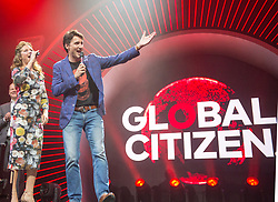 Prime Minister Justin Trudeau and his wife Sophie Gregoire Trudeau introduce Coldplay to open the Global Citizen concert at the G20 summit in Hamburg, Germany on Thursday, July 6, 2017. Photo by Ryan Remiorz/CP/ABACAPRESS.COM