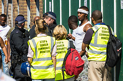 London, August 27 2017. With a major police anti-terrorism and crime operation underway, stop and search monitors observe searches as Family Day of the Notting Hill Carnival gets underway. The Notting Hill Carnival is Europe's biggest street party held over two days of the bank holiday weekend, attracting over a million people. © Paul Davey.