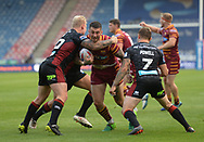 Oliver Roberts of Huddersfield Giants is taken high by Gabe Hamlin of Wigan Warriors during the Betfred Super League match at the John Smiths Stadium, Huddersfield<br /> Picture by Richard Land/Focus Images Ltd +44 7713 507003<br /> 12/07/2018