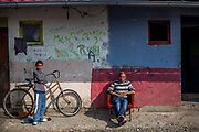 A boy and a man at the Roma settlement 'Budulovska Street'. The city of Moldava nad Bodvou has roughly 11200 inhabitants, about 1980 (18%) of them have Roma ethnicity and around 800 are living at the segregated settlement 'Budulovska Street' (2014).