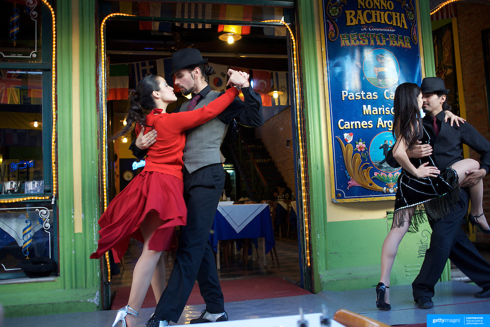Tango dancers peform in the bars of the tourist region of La Boca near the famous Boca Juniors football stadium, La Bombonera, in La Boca region of Buenos Aires, Argentina, 25th June 2010. Photo Tim Clayton.